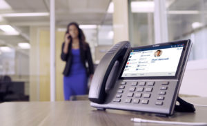 Mitel business telephone system handset on a desk in an office